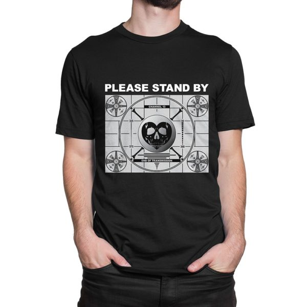 "Man wearing black Fear What You Wear t-shirt depicting test pattern with caption ""Please Stand By"""