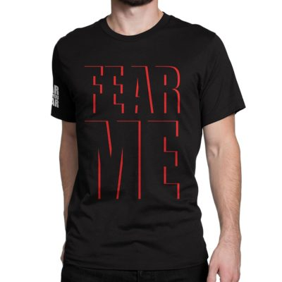 "Man wearing black Fear What You Wear t-shirt with caption ""FEAR ME"" red text outlines"