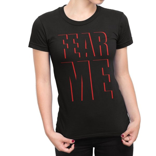 """Woman wearing black Fear What You Wear t-shirt with caption """"FEAR ME"""" red text outlines"""