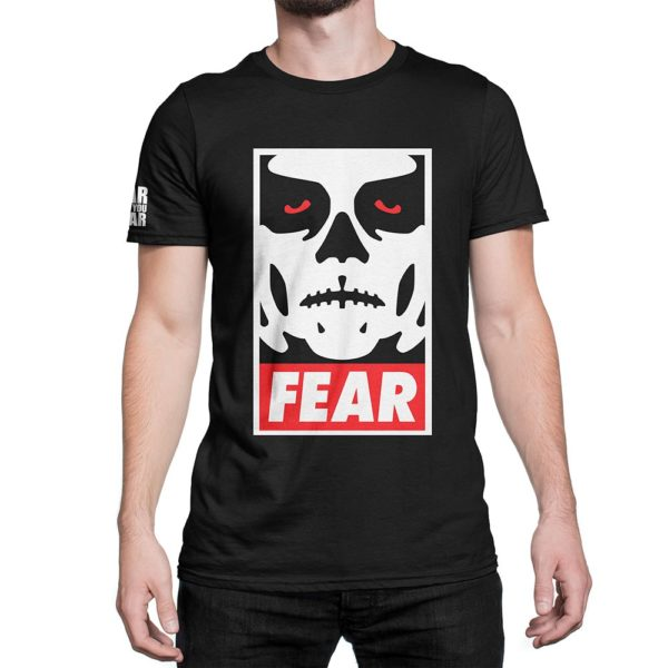 Man wearing Fear What You Wear t-shirt depicting Obey parody with zombie face and caption FEAR