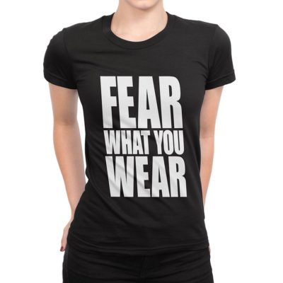 Woman wearing black Fear What You Wear t-shirt with Fear What You Wear logo